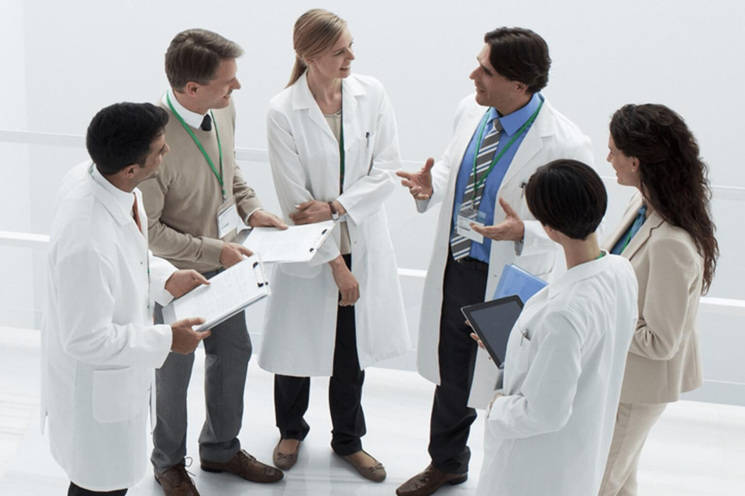 Clinicians meeting in a hallway