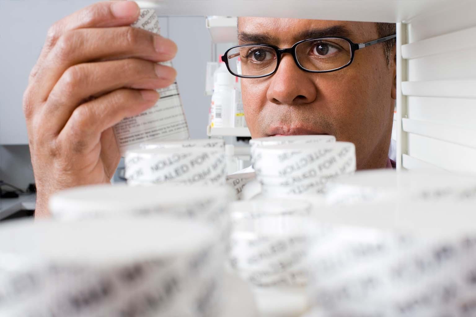 phamacist holding bottle of pills