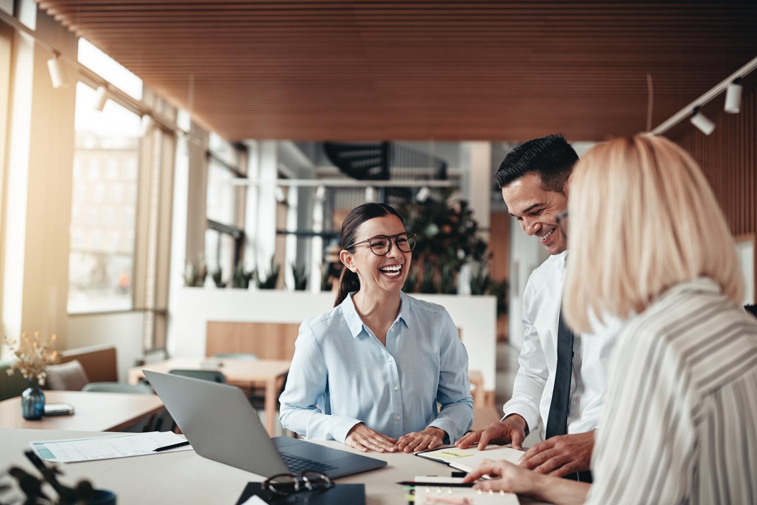 people smiling at desk