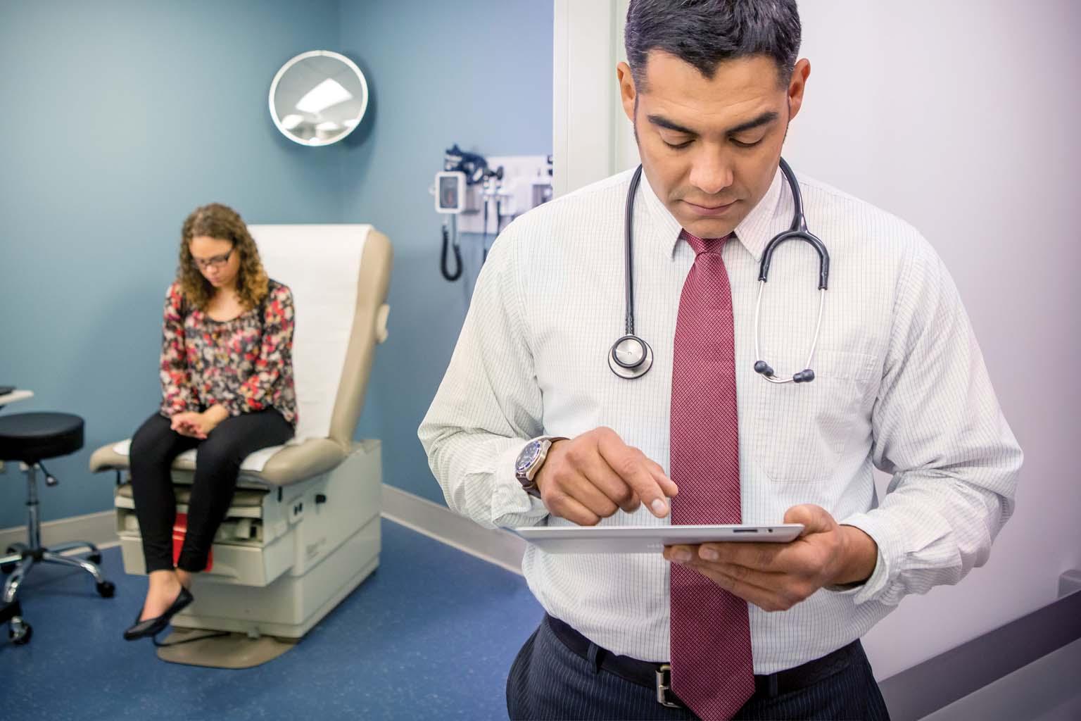 doctor with patient in exam room