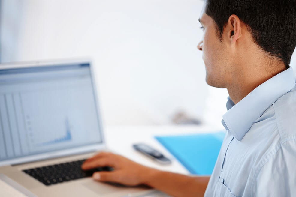 male-reviewing-analytics-on-laptop-healthcare