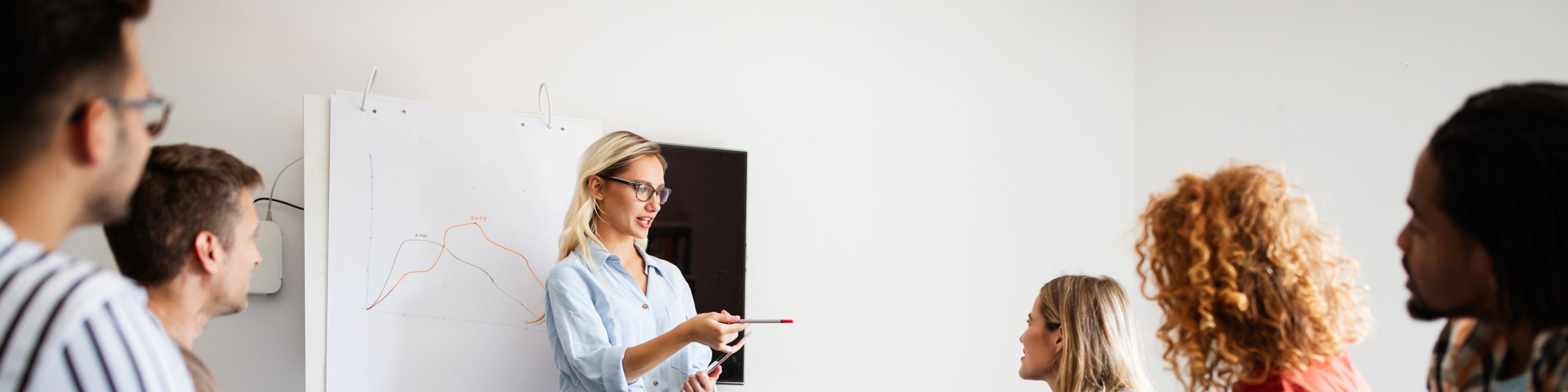 woman at white board
