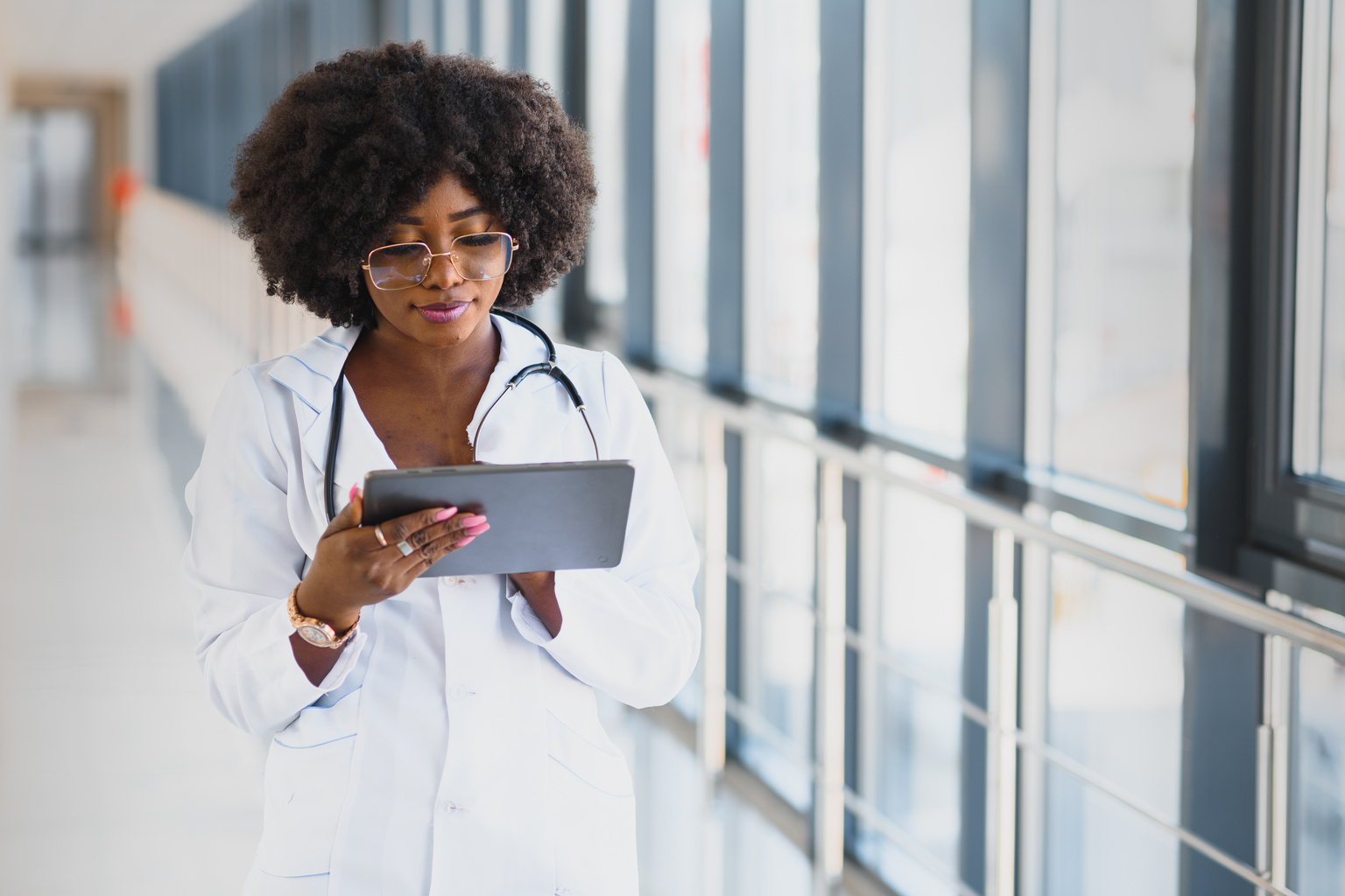 Doctor walking down hall with tablet