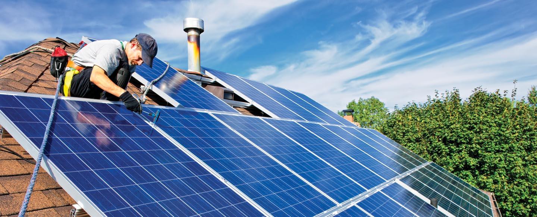 men installing a solar panel